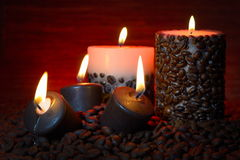 Coffee beans and burning candles Stock Photos