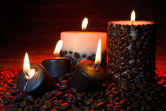 Coffee beans and burning candles Stock Image