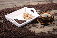 Coffee beans and cakes. Coffee beans in a coffee cup and some cake, biscuits Stock Images