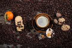 Coffee beans and cakes Royalty Free Stock Photo