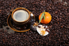 Coffee beans and cakes Stock Photography
