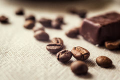 Coffee beans and candy cane.spilled coffee beans. Chocolate Royalty Free Stock Photography