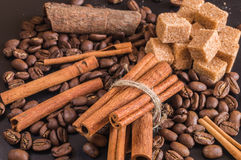 Coffee beans; cane sugar and cinnamon sticks. Stock Image