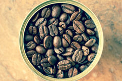 Coffee beans canned in tin top view Royalty Free Stock Photos