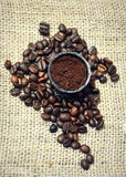 Coffee beans. On canvas background - close up Stock Images