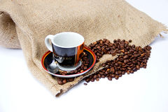 Coffee Beans with Canvas Bag and Coffee Cup. Isolated on White Background Royalty Free Stock Image