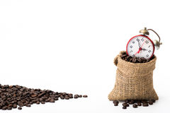 Coffee beans in a canvas bag. With red alarm clock Royalty Free Stock Photography