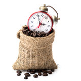 Coffee beans  in a canvas bag. Coffee beans in a canvas bag with red alarm clock Stock Images