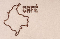 Coffee beans on canvas: Colombia and Cafe. Coffee beans on canvas in the shape of the map of Colombia and the word Cafe Stock Image