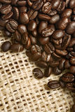 Coffee beans from canvas sack Royalty Free Stock Photography