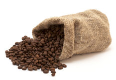 Coffee beans in canvas sack Royalty Free Stock Images