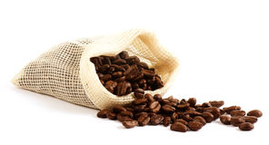 Coffee beans in canvas sack Stock Images