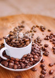 Coffee. Beans in cap and on the table Stock Photo