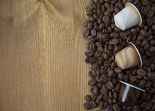 Coffee Beans and Capsules on Wooden Background Top View Copy Space Royalty Free Stock Image