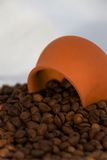 Coffee beans with ceramic cup Stock Photography