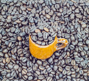 Coffee beans in ceramic cup on coffee beans Stock Photo