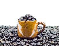 Coffee beans in ceramic cup on coffee beans Royalty Free Stock Images