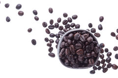 Coffee beans in ceramic cup isolated in white background (focus Stock Photo