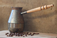 Coffee beans and cezve Stock Photography