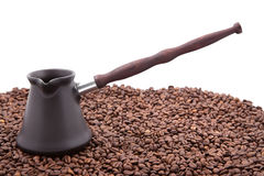 Coffee beans and cezve Stock Images