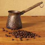 Coffee beans and cezve Royalty Free Stock Photography