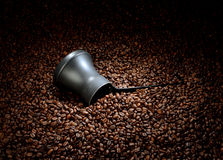 Coffee beans with cezve Royalty Free Stock Photography