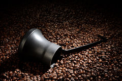 Coffee beans with cezve Royalty Free Stock Image
