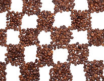 Coffee beans in the chess field Stock Photography