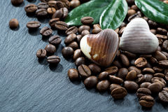 Coffee beans and chocolate candies on a dark background Stock Images