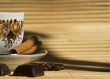 Coffee beans,chocolate and Cinnamon with coffee ca Royalty Free Stock Photography