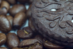Coffee beans and chocolate cookie close up. Selective focus Royalty Free Stock Photos