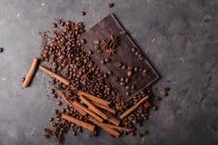 Coffee beans with chocolate dark chocolate. Broken slices of chocolate. Chocolate bar pieces. Stock Photos