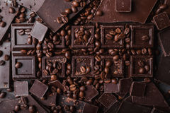 Coffee beans with chocolate dark chocolate. Broken slices of chocolate. Chocolate bar pieces. Stock Image