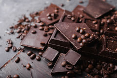Coffee beans with chocolate dark chocolate. Broken slices of chocolate. Chocolate bar pieces. Stock Photo