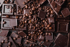 Coffee beans with chocolate dark chocolate. Broken slices of chocolate. Chocolate bar pieces Stock Images