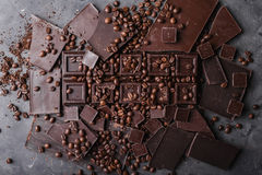 Coffee beans with chocolate dark chocolate. Broken slices of chocolate. Chocolate bar pieces. Stock Photography