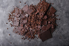 Coffee beans with chocolate dark chocolate. Broken slices of chocolate. Chocolate bar pieces. Royalty Free Stock Image