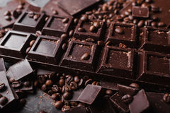 Coffee beans with chocolate dark chocolate. Broken slices of chocolate. Chocolate bar pieces. A large bar of chocolate on gray abstract background. Coffee Royalty Free Stock Photos
