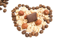 Coffee beans, chocolate, peanuts and hazelnuts. On white stock photography