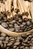 Coffee beans and cinnamon. Close up of coffee beans and cinnamon Stock Image