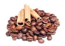 Coffee beans and cinnamon Stock Photos