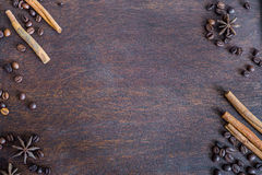 Coffee beans, cinnamon and anise stars on dark wooden backround Royalty Free Stock Photo