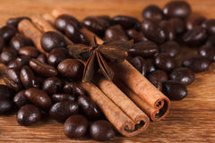 Coffee beans with cinnamon and anise on wooden table. Closeup Stock Photos