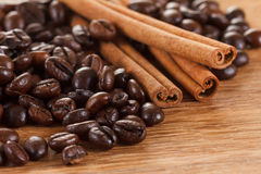 Coffee beans with cinnamon and anise on wooden table. Closeup Stock Photo