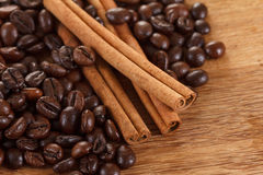 Coffee beans with cinnamon and anise on wooden table. Closeup Royalty Free Stock Images