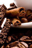 Coffee beans, cinnamon and black chocolate Royalty Free Stock Photography