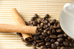 Coffee beans and Cinnamon with cap Royalty Free Stock Photos