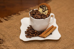 Coffee beans cinnamon cookie white cup and saucer Stock Photo