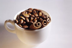 Coffee beans and cinnamon in the cup Royalty Free Stock Images