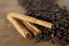 Coffee beans and cinnamon Stock Photos